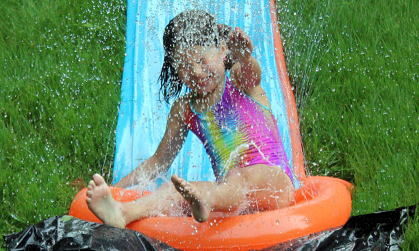 Girl on water slide.